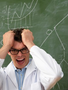 Confused Scientist in Front of Blackboard